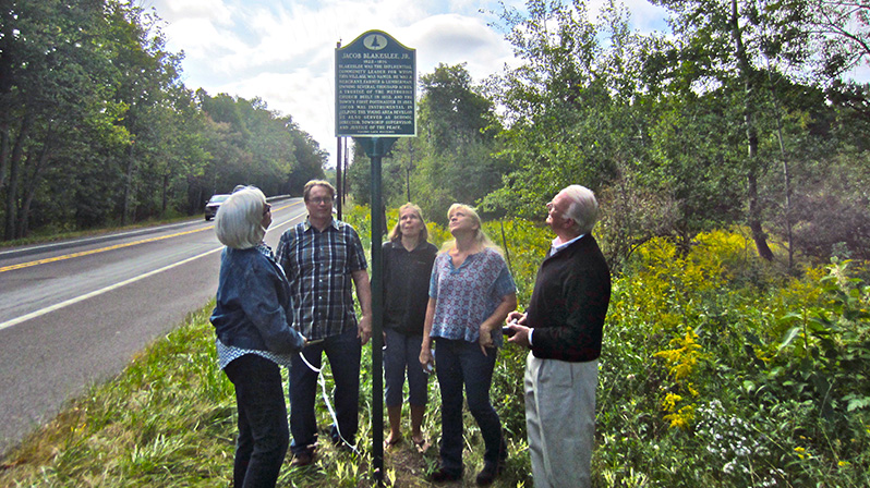 From left, Susan Blakeslee Borden, William Blakeslee, Wendy Blakeslee White, Amy Blakeslee Henry and Jerome Blakeslee admire the historical marker honoring their ancestor, Jacob Blakeslee Jr.