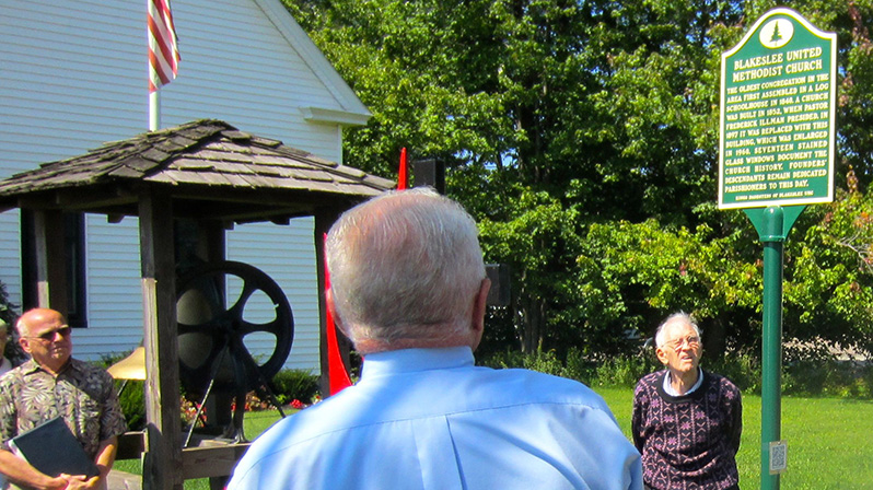 Gene Kerrick unveils and presents the Blakeslee United Methodist Church historical marker.