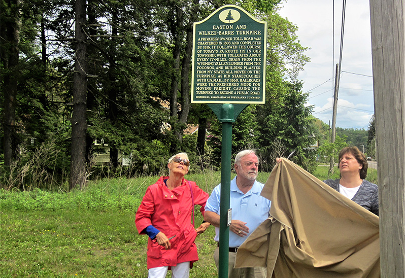 From left, Marge Brennan, Jerry Hanna and Kim Kerrick, all members ot the Historical Association of Tobyhanna Township, unveil the marker on May 27, 2017.