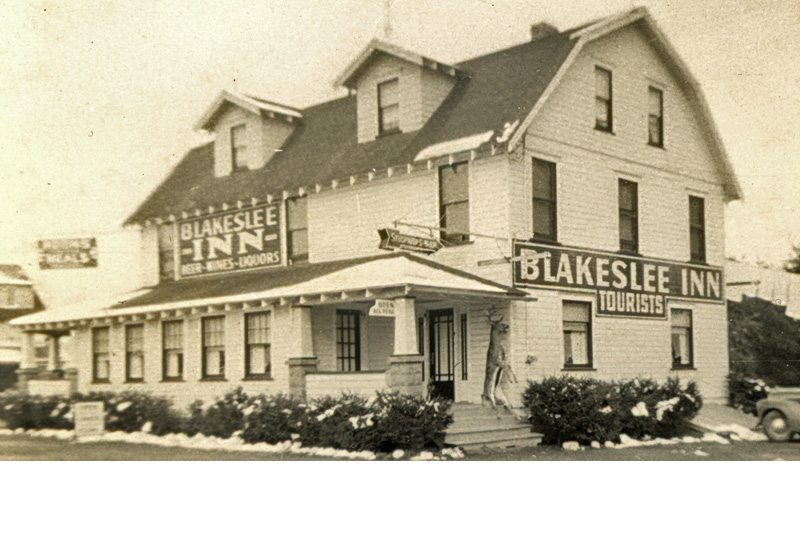 Blakeslee Inn during buck season, with a trophy hanging on the front porch.