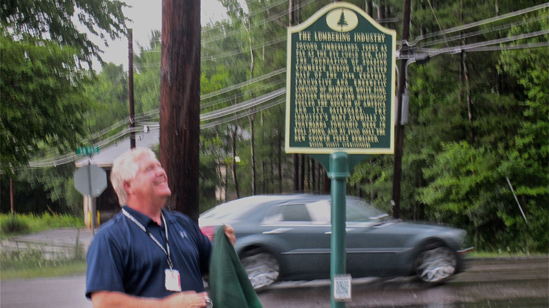 Monroe County Commissioner John Christy unveils the marker.