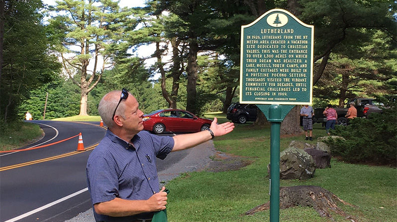 Brendon Carroll, president of Pinecrest Community Trust, presents the Lutherland historical marker for the first time.