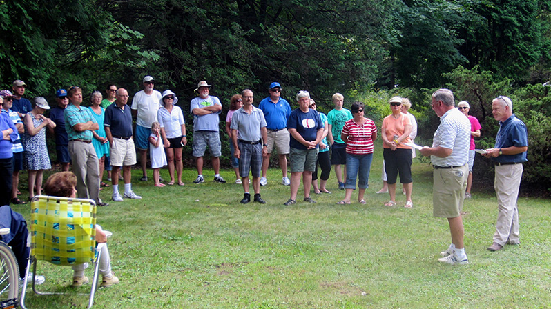 Rick Bodenschatz, second from right, talks about Lutherland with the group gathered for the marker dedication.