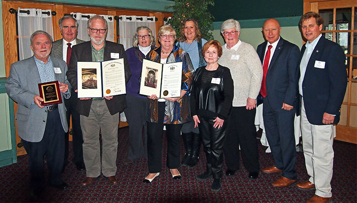 Presentation of the MCHA Heritage Award, February 25, 2018. From left: Jerry Hanna, Bruce Denlinger, Brendon Carrol, Kris Avery, Trudi Denlinger, Heidi Picard, Marianne Hajduk, Judy Avery, state Sen. Mario Scavello and state Rep. Jack Rader.