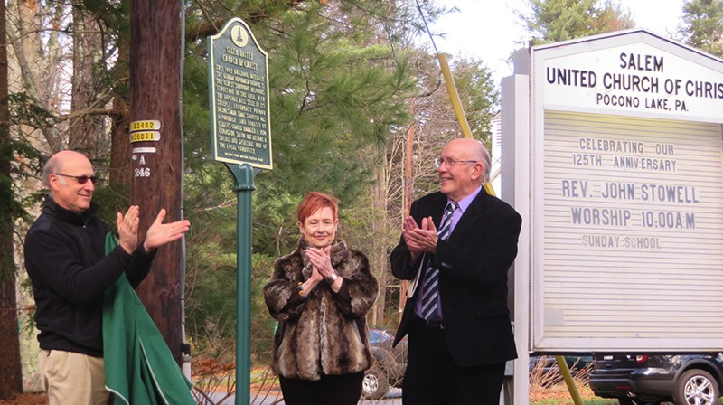 The marker is revealed by Dave Sleightholm, Salem UCC Consistory president; Marianne Hajduk, president of the Sullivan Trail Questers, and the Rev. John Stowell, pastor of UCC. (Bob Baechtold Photo)