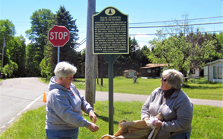 The Isaac Stauffer marker is unveiled by Judy Avery, left, and Kris Avery on June 3, 2017.