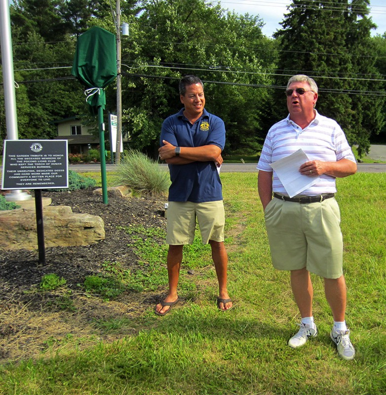Rick Bodenschatz of MATT, right, welcomes Tobyhanna Township supervisors, state Rep. Jack Rader, and members of the Pocono Lions Club to the marker unveiling ceremony. At left is Pocono Lions President Sean Naughton.
