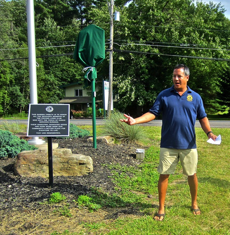 Sean Naughton, president of the Pocono Lions Club, shares the history of the club. The Tobyhanna Township historical marker was sponsored by the Pocono Lions, which also established the memorial garden where the marker was set.