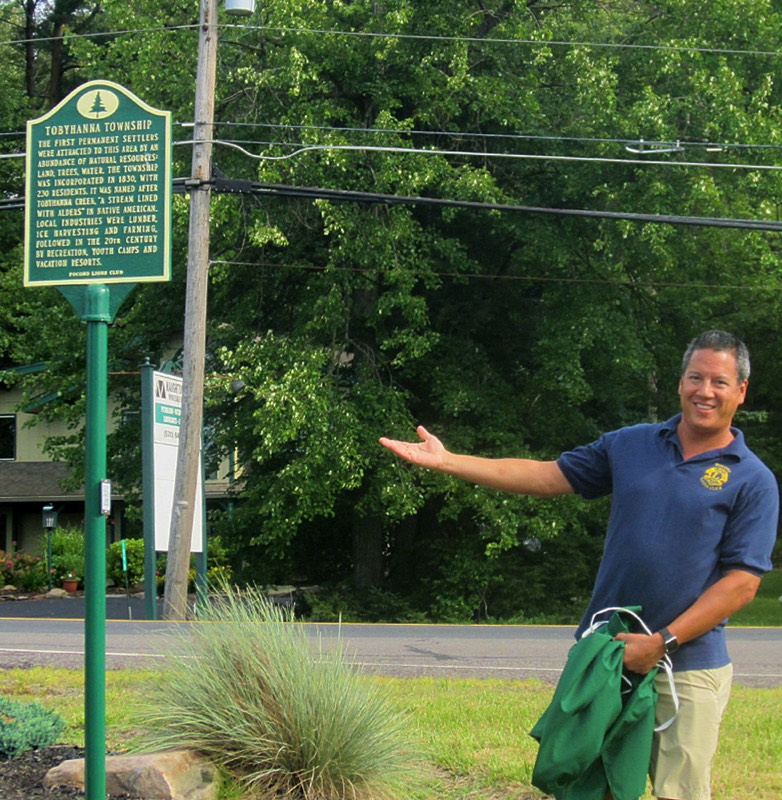 The Tobyhanna Township historical marker is unveiled by Pocono Lions Club President Sean Naughton.