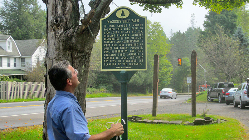 John Kerrick unveils the Wagner's Tree Farm historical marker.
